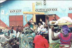 HENRY PREACHING TO VILLAGE CROWD